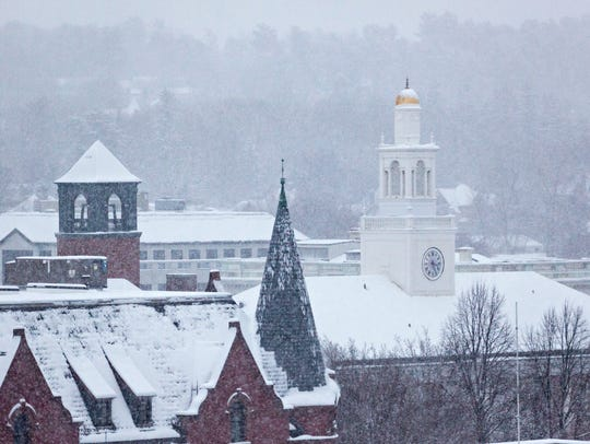 Snow falls over City Hall and blankets downtown Burlington