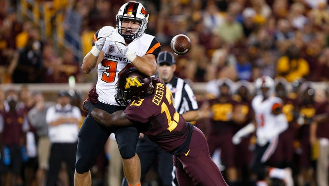 Oregon State running back Ryan Nall (34) drops the ball as is tackled by Minnesota linebacker Jonathan Celestin (13), during an NCAA college football game Thursday, Sept. 1, 2016, in Minneapolis.