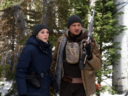Jane (Elizabeth Olsen, left) and Cory (Jeremy Renner)