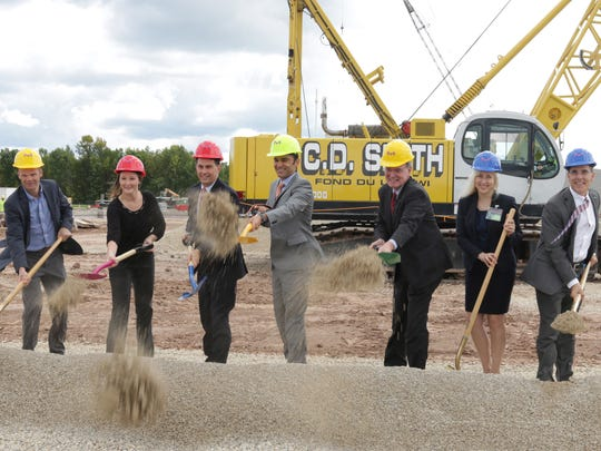 Dignitaries break ground for MillipopreSigma's $64 million, 80,000-square-foot facility addition Tuesday, September 5, 2017, in Sheboygan Falls, Wis.  MilliporeSigma said the addition to its Sheboygan Falls location is expected to add an additional 175 employees at that location.