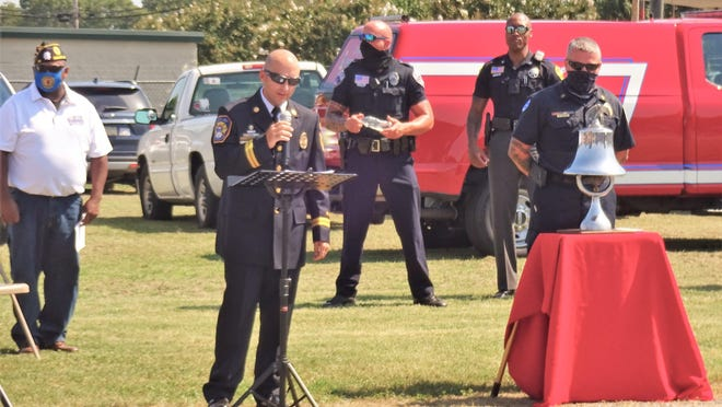 Battalion Commander Quentin Cash shares the significance of ringing the bell during the remembrance ceremony hosted by the American Legion Post 82 on Monday.