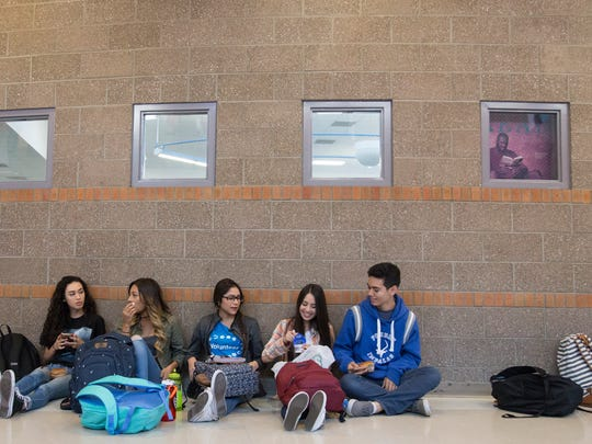 From the left, Julisa Alvarez, Chelsie Chavira, Johanna Zapata, Jacky Rodriguez, and Julio Flores eat lunch together in the hallways of Poudre High School Monday, October 3, 2016.