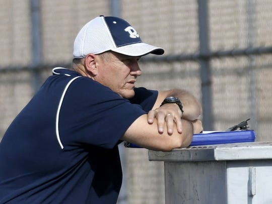 Redwood High School tennis coach Russ Brown watches
