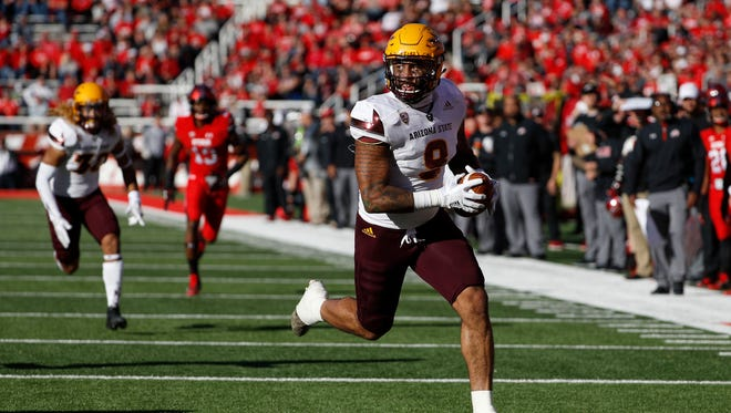 Oct 21, 2017; Salt Lake City, UT, USA; Arizona State Sun Devils tight end Jay Jay Wilson (9) runs back an interception for a touchdown  on a pass intended for Utah Utes running back Zack Moss (2) in the fourth quarter at Rice-Eccles Stadium. Mandatory Credit: Jeff Swinger-USA TODAY Sports
