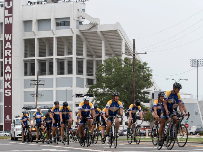 The Ability Experience cycling team performs a ride