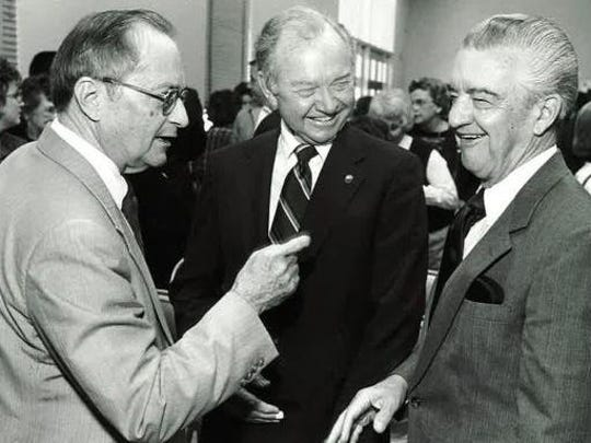 Renowned University of Mississippi accountancy professor Gene Peery, left, lectures Eddie DeMiller, right, and Howard Davidson at the 1988 celebration of the funding of the Peery Chair in Accountancy.
