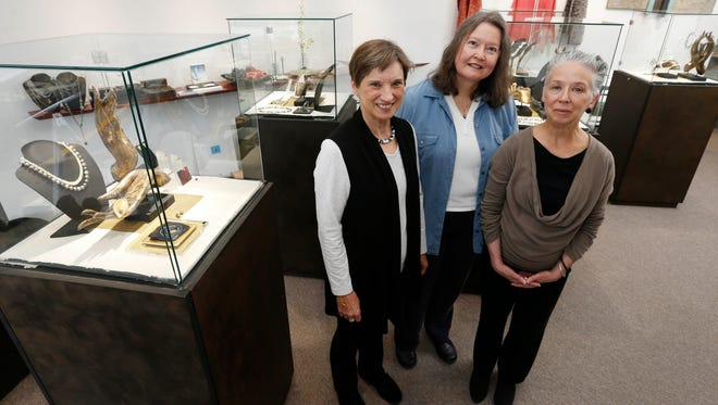 Sheena Thomas (from left), Marta Jones-Couch and Mel Parks, owners of Elements, Ltd., are celebrating 20 years of business with a jewelry show in their store at the Shops at Roosevelt in Des Moines.