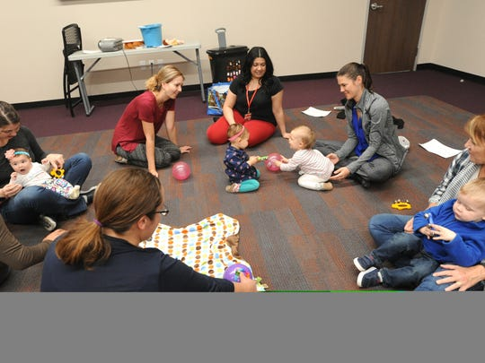 A baby steps group meets at the new South Branch of the Abilene Public Library Monday, Nov. 28, 2016.