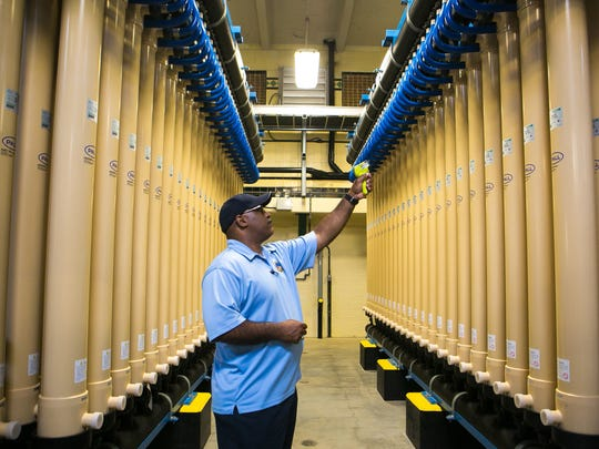 George Flowers, water production supervisor, takes temperature readings at the Brandywine Filter Plant.