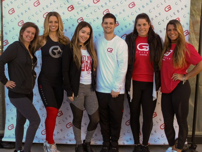 Staff members of CycleBar Closter. CycleBar opened