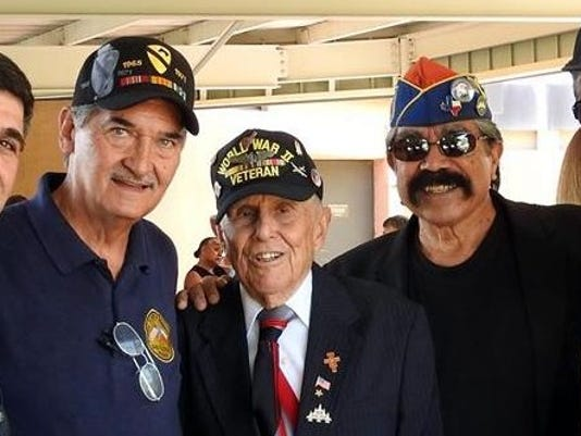 636218908611155491-Dr.-Torres-with-vets.jpg