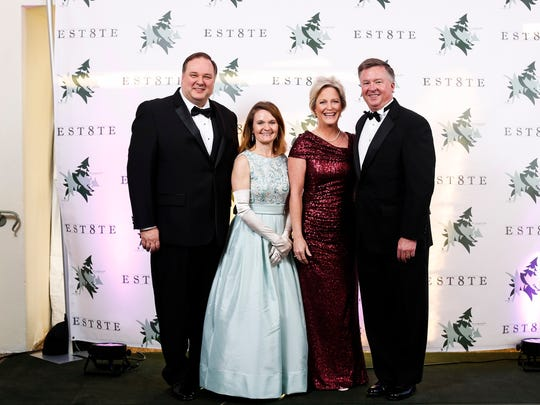 At the Evergreen Ball are event co-chair Tim Chandler, Katie Chandler, Jody Curtis and co-chair Sam Curtis.