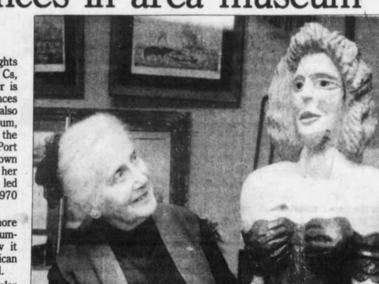 A clip from the Asbury Park Press showing Gertrude Neidlinger and a figurehead at the Shoal Harbor Museum in 1987.
