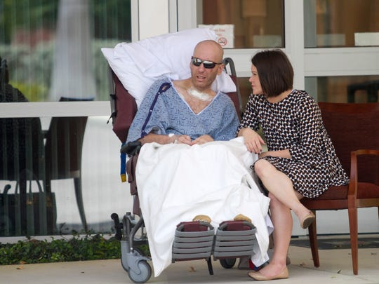Jake Booth and his wife Jasmine Stanley share a moment outside of Promise Hospital on Thursday, April 21, 2016, in Fort Myers.