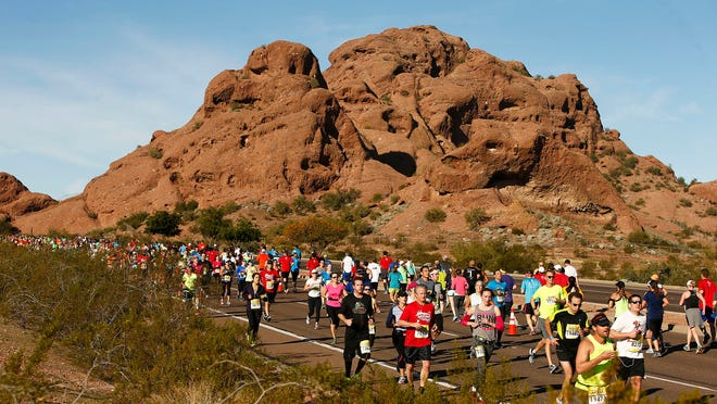 Runners pass through the buttes on east McDowell Road during the P.F. Chang's Rock 'n' Roll Arizona Half Marathon in January. Participation numbers in half marathons have quadrupled since 2000, but the ratio of cardiac-related incidents to participants has remained steady, research shows.