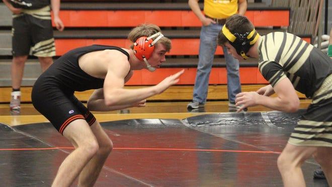 Macomb's Caden Green wrestles a match last season.