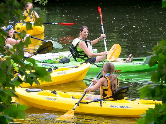 Rachel Singer gathers Murfreesboro Parks and Rec. Explorer Camp  campers together on the Stones River as they prepare to tour the  waterway from the Walter Hill Dam in a kayak.