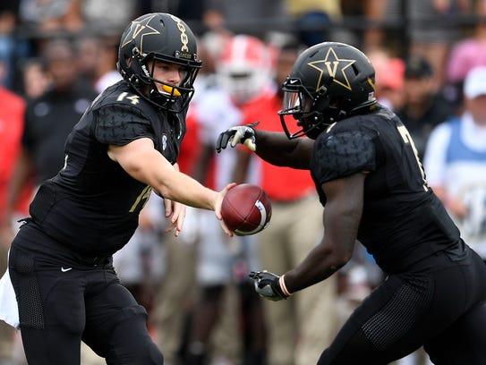 Vanderbilt quarterback Kyle Shurmur (14) hands off