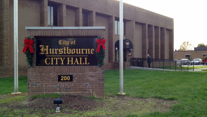 The City of Hurstbourne sign is decorated for the holidays at at grand opening event Nov. 24, 2015 for the new city hall, 200 Whittington Pkwy.