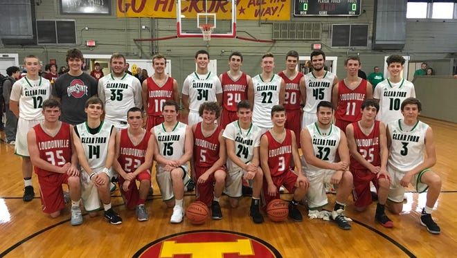 """The Clear Fork and Loudonville varsity basketball teams pose for a group shot during a recent trip to Indiana to scrimmage in the gym made famous by the film classic """"Hoosiers."""""""