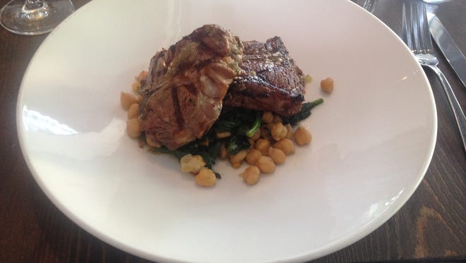 The Kitchen's Crego Farms char grilled lamb was tender and moist, and served with sautéed greens and garbanzo beans.