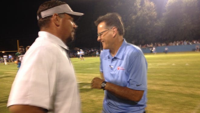 USJ head coach Mickey Marley and South Side head coach Jason Driggers share a laugh between their games at North Side Friday.