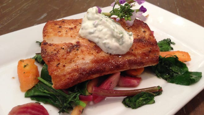 Seared Cobia with fresh spring vegetables by Chef Gus Silivos.