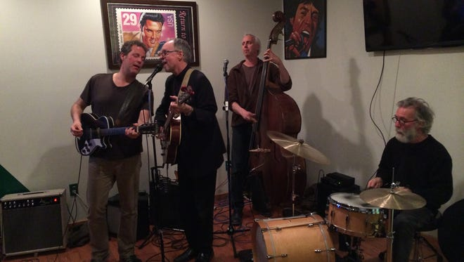 Mark Dziuba, left to right, Joe Fitz, Robert Bard and Chris Bowman perform at Uncle Willy's in Kingston.