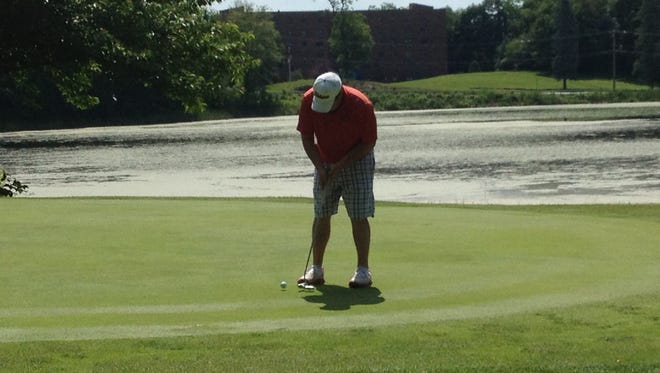 Brian Viola putts during Sunday's action at the Ralph DeStefano Memorial match play tournament at College Hill Golf Course.