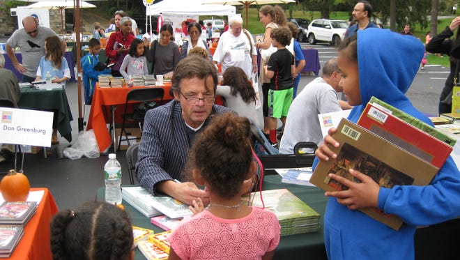 """""""Madlenka"""" creator Peter Sis signs copies of his work for attendees of last year's Chappaqua Children's Book Festival. He'll return for this year's event."""