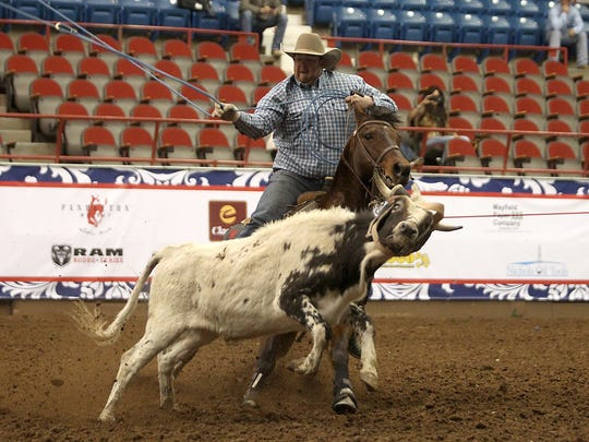 Shawn Bessette ropes the legs of his steer after teammate  Sid Sporer catches its head during the Team Roping competition on Day 1 of Slack Tuesday, February 7, 2017. Bessette and Sporer tied fifth with Tate Kirchenschlager and Trevor Kirchenschlager; and Cole Markham and Nick Simmons with 4.6 seconds.