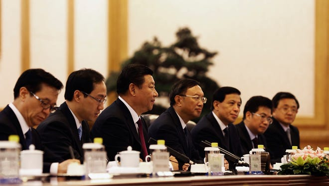 Chinese President Xi Jinping, third left, is going forward with self-criticism of the Communist Party.