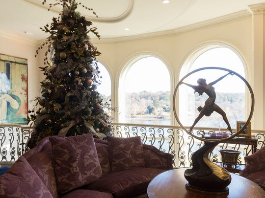 "The Christmas tree in the Riverview Room, which is accessed from the east hallway and from the ""O Club"" below it, has a mulberry, cream and silver theme designed by Samuel Franklin Floral Design."