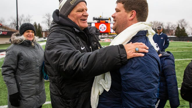 Rochester head football coach Derek Leonard hugs his father, Sacred Heart-Griffin head coach Ken Leonard, after the Rockets defeated Chicago St. Rita 42-28 in the IHSA Class 5A State Championship game at Huskie Stadium on the campus of Northern Illinois University, Saturday, Nov. 30, 2019, in DeKalb.