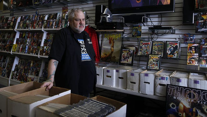 Tony Grove, owner of Tony's Kingdom of Comics, stands in his old Keizer shop, which recently relocated to 3856 River Road N.