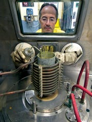 Plutonium work at Los Alamos generally takes place in glove boxes at PF-4, like the one shown here.
