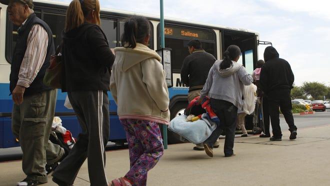 Riders load onto a Monterey-Salinas Transit bus.