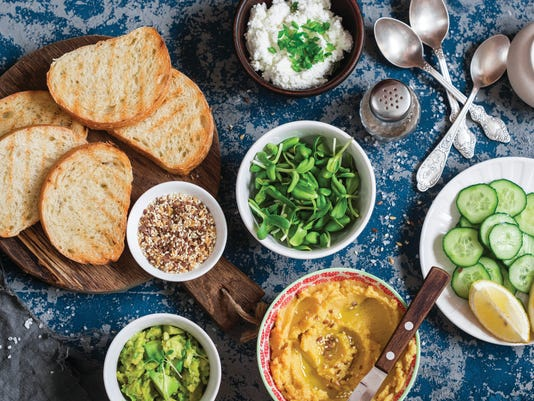 Prepare sandwiches - bread, sprouts, avocado dip, hummus, cheese, cucumber