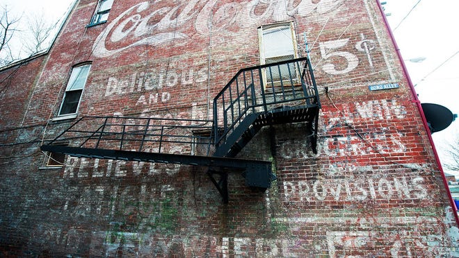 In the late 1950's Eugene Wise bought the building next to him to expand. The first floor was a pharmacy and had a soda fountain. The painted sign remains on the side of the building from that time. Paul Kuehnel - Daily Record/Sunday News