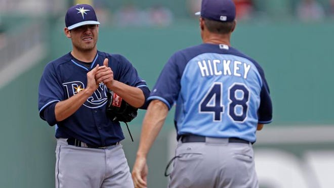 Tampa Bay Rays pitching coach Jim Hickey walks to the mound to talk to starting pitcher Matt Moore during Sunday's game against the Boston Red Sox at JetBlue Park.