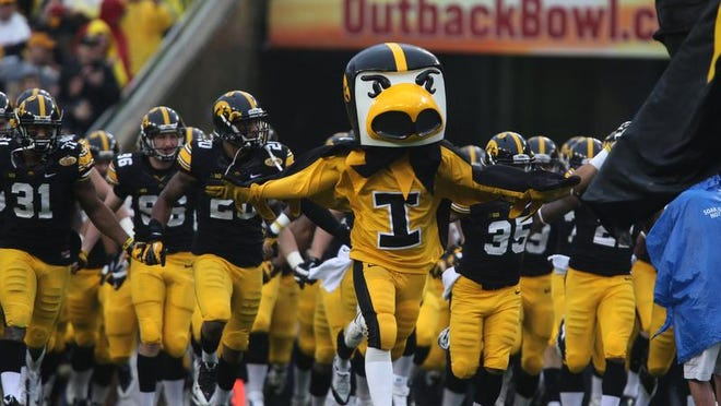 Herky leads the Iowa football team onto the field for their game against LSU in the Outback Bowl on Wednesday, Jan. 1, 2014, in Tampa, Florida. (Bryon Houlgrave/The Register)