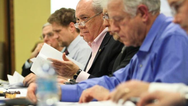 Commissioner David Proffitt listens as residents spoke out in opposition to a proposed residential development  at Glenmary golf course in 2014.