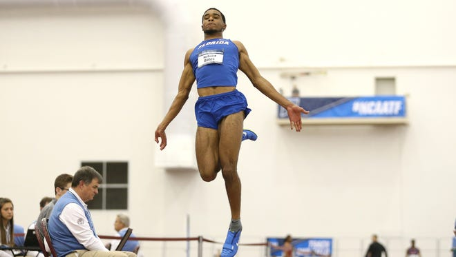DeAndre Bates takes flight during the NCAA Indoor Track and Field Championships on Friday, March 10, 2017 at Rhonda and Frosty Gilliam Jr. Indoor Track Stadium in College Station, Texas.