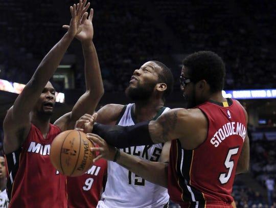 Milwaukee Bucks center Greg Monroe, center, is fouled