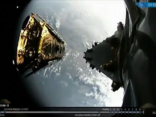 One of 10 Iridium NEXT satellites deploys from the upper stage of a SpaceX Falcon 9 rocket following its launch from Vandenberg Air Force Base in California at 8:37 a.m. EDT Monday, Oct. 9. In the background, several satellites deployed minutes earlier can be seen floating in low Earth orbit.