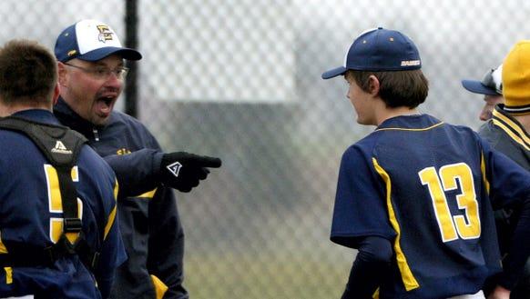 Elco coach Chris Weidner congratulates pitcher Cole