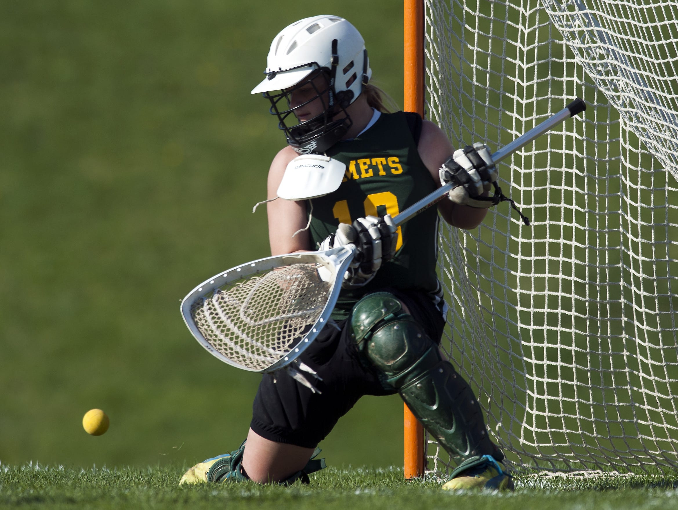 BFA goalie Maria Magnan (19) makes a save during the girls lacrosse game between BFA St. Albans and Champlain Valley on Thursday in Hinesburg.