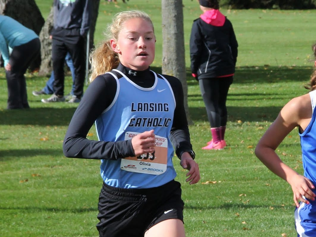 Olivia Theis has the top time among girls runners in the Lansing area.
