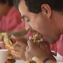 A ketchup slide competition is part of the annual Burger Fest in Seymour.