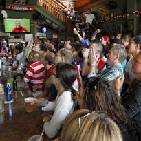 Nomad Nacional fills in the lineup card for its World Cup party in Walker's Point